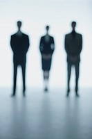 Silhouettes of two businessmen and a businesswoman