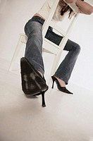 Low angle of woman on chair