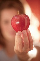 Woman holding apple.