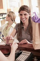 Woman purchasing with credit card.
