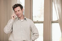 Man talking on telephone.