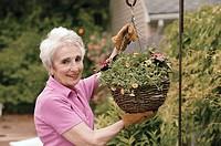 Woman gardening, portrait.