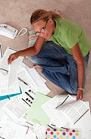 Woman with paperwork, portrait, aerial angle.