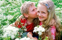 Young boy kissing a young girl (thumbnail)