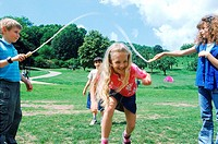 Young children playing with skipping rope (thumbnail)