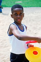 Young boy playing with a Frisbee