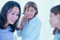 Teenager talking on telephone.