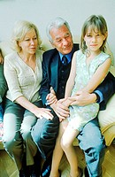 Portrait of a young girl sitting with her grandparents (thumbnail)