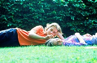 Young couple lying in the grass together