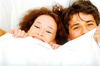 Close-up of a couple hiding under the sheets