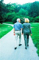 Elderly couple walking in a garden