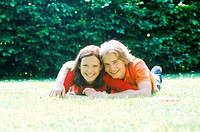 Portrait of young couple lying on the grass
