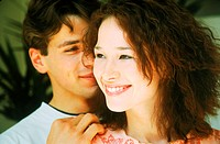 Young couple smiling (thumbnail)