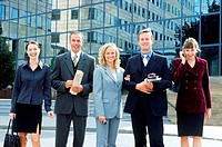 Portrait of a group of business executives standing outdoors
