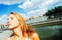 Young woman looking up with eyes closed (thumbnail)