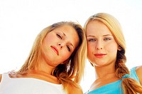 Low angle view of two young woman looking down (thumbnail)