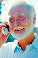 Senior adult man talking on a mobile phone