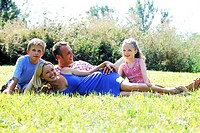 Portrait of parents with children in park (thumbnail)