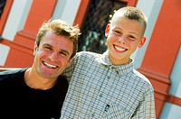Portrait of a father and son smiling