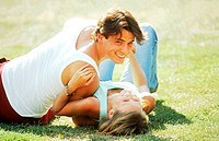 Young couple lying on a lawn