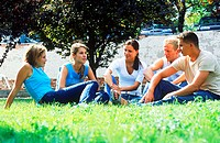 A group of young people sitting on a lawn (thumbnail)