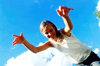 Low angle view of a young woman with arms reaching forward (thumbnail)