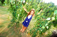 A young girl in a park (blurred) (thumbnail)