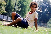 Young boy playing on the grass