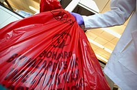 Removing hazardous waste bag