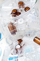 High angle view of vials and bottles in glass containers