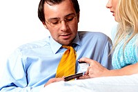 Businessman and a businesswoman looking at credit cards