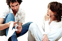 Young man sitting with a young woman holding a receipt