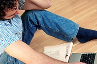 High angle view of a young man sitting in front of a laptop (thumbnail)