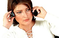 Close-up of a businesswoman using two mobile phones (thumbnail)