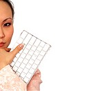 Close-up of a businesswoman holding a computer keyboard