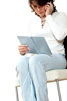 Businesswoman talking on a mobile phone and reading a diary