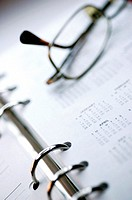 Close-up of eyeglasses on a personal organizer