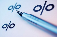 Close-up of a fountain pen and percentage signs