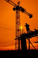 Silhouette of Construction Supervisor on construction location, sunset in the background, Washington DC