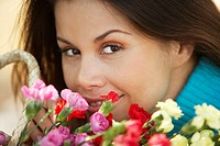 Close-up of a young woman with a bouquet of flowers