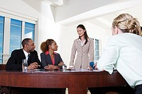 Three businesswomen and a businessman in an office