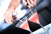 Close-up of a person's hand preparing a cocktail (thumbnail)