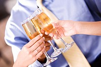 Three people toasting with champagne flutes