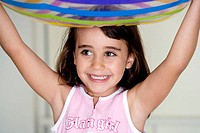 Close-up of a girl carrying an inflatable ball over her head