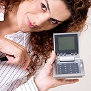 Portrait of a young woman holding a calculator