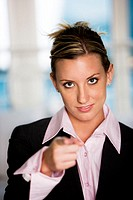 Portrait of a businesswoman pointing forward