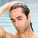 Close-up of a mid adult man in a swimming pool with his eyes closed