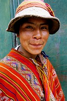 Quechua teenager wearing traditional clothes. Ollantaytambo, Perù