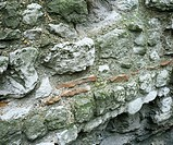 Roman wall. Section of the remains of the London Roman wall. The wall is composed of bricks of Kentish ragstone, a sandy Cretaceous limestone, and red...