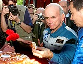 Dennis Tito (b.1940), space tourist, (middle) being photgraphed eating after returning from the Soyuz TM-32 spaceflight, Arpil 2001. Tito, a multi- mi...
